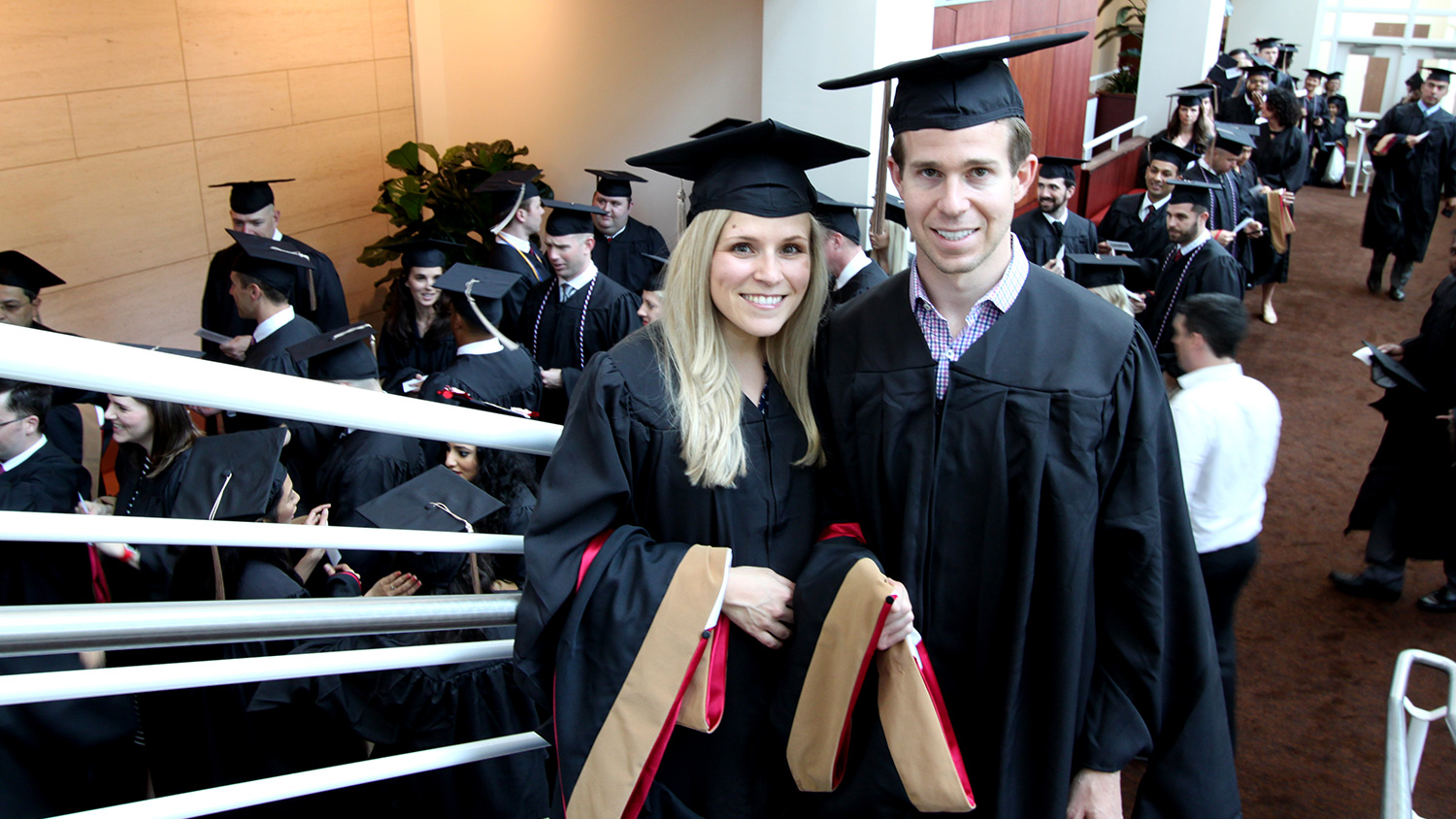 Nicole and Robert Panor with their graduate hoods prior to lining up for the Jenkins MBA Hooding Ceremony.
