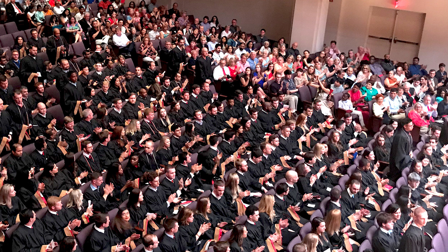 Family and friends join Poole College's Jenkins graduate students for their 2019 Hooding Ceremony at Meymandi Concert Hall in Raleigh.