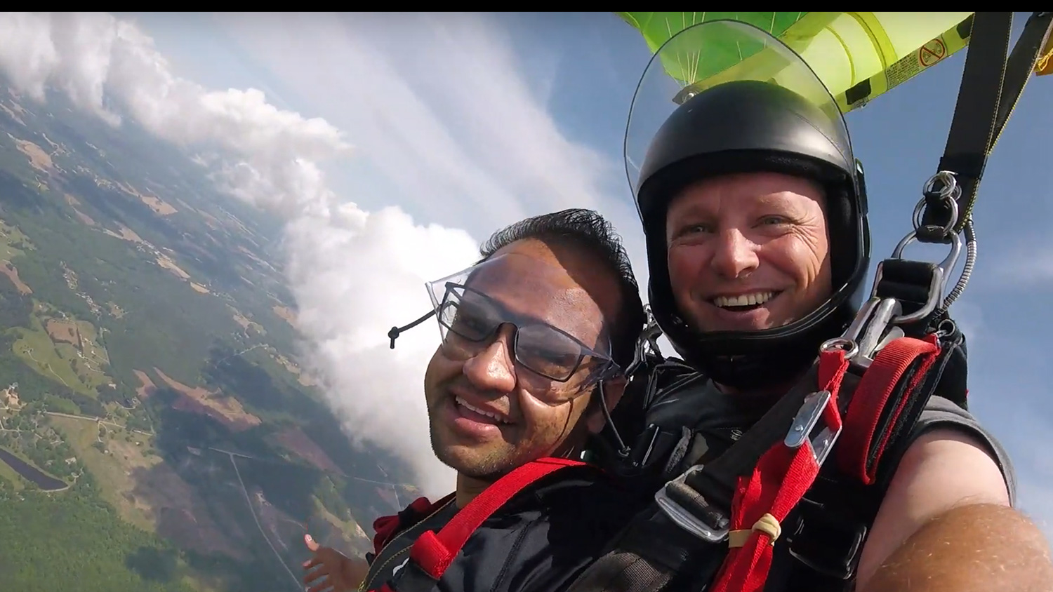 Sahir Patel, in the air with his Triangle Skydiving tandem partner